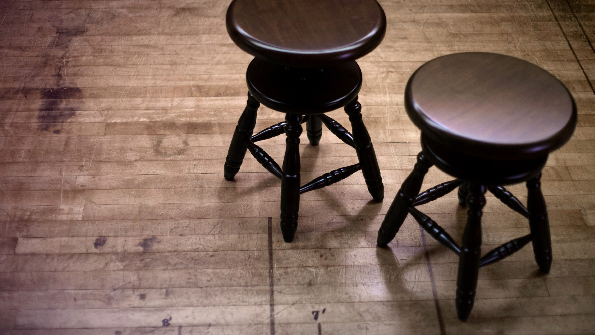 Two wooden piano stools